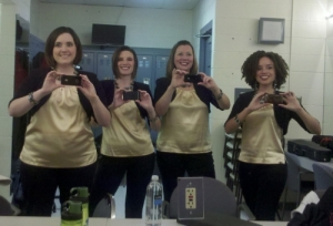 Epic, a female barbershop quartet, poses for a self portrait in the dressing room